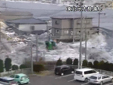 Footage of the tsunami striking Kamaishi shot from a roof.